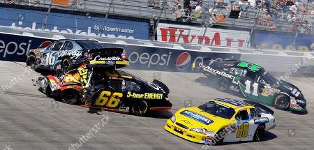 Colin Braun, Steve Wallace, Kelly Bires, Brian Scott. Colin Braun (16) hits Steve Wallace (66) as Brian Scott (11) spins and Kelly Bires (88) drives past during the NASCAR Nationwide series Scotts Turf Builder 300 auto race at Bristol Motor Speedway in Bristol, Tenn