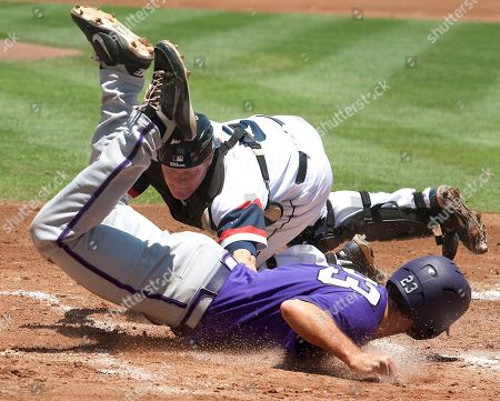 Stock Picture of TCU's Zac Jordan (23) slides past the tag from Dayton catcher Josh Jeffery in the second inning of an NCAA college baseball tournament regional game, in College Station, Texas. TCU defeated Dayton 28-12