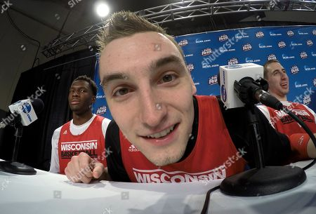 Wisconsin's Sam Dekker looks at a camera during the first half of the NCAA Final Four college basketball tournament championship game, in Indianapolis
