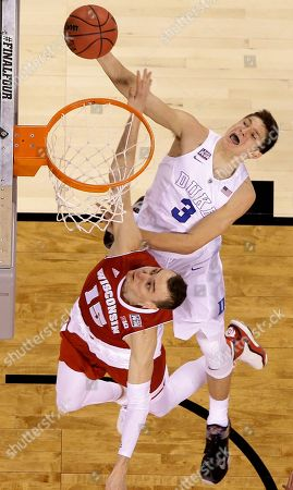 Duke's Grayson Allen (3) shoots against Wisconsin's Sam Dekker (15) during the second half of the NCAA Final Four college basketball tournament championship game, in Indianapolis