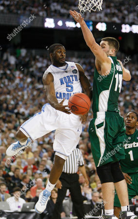 North Carolina's Ty Lawson (5) drives to the basket past Michigan State's Goran Suton during the championship game at the men's NCAA Final Four college basketball tournament, in Detroit