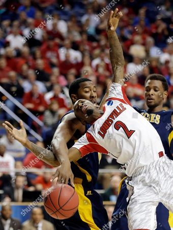 Russ Smith, Lawrence Smith. Louisville guard Russ Smith (2) is fouled by North Carolina A&T forward Lawrence Smith (0) as he drives to the basket during the second half of a second-round game in the NCAA college basketball tournament, in Lexington, Ky