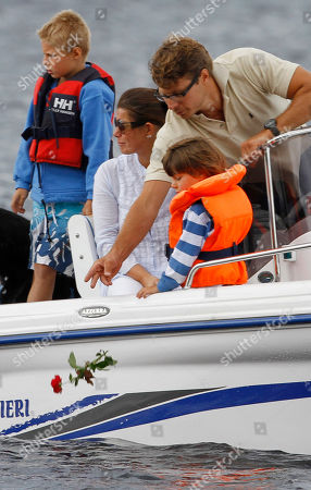 Stock Picture of A family drops red roses from their boat into the sea close to Utoya island, near Oslo, Norway, where gunman Anders Behring Breivik killed at least 76 people. The defense lawyer for Anders Behring Breivik said Tuesday his client's case suggests he is insane, adding that someone has to take the job of defending him but that he will not take instructions from his client. Geir Lippestad told reporters that the suspect in the bombing on the capital and the brutal attack on a youth camp that killed at least 76 people is not aware of the death toll or of the public's response to the massacre that has rocked the country