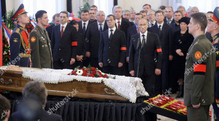 Dmitry Medvedev,Vladimir Putin. Russian President Dmitry Medvedev, center, and Prime Minister Vladimir Putin, right, pay last respect to former Russian Prime Minister Viktor Chernomyrdin during a memorial ceremony in Moscow, Russia, . Viktor Chernomyrdin, who served as Russia's prime minister in the turbulent 1990s as the country was throwing off communism and developing as a market economy, died Wednesday. Chernomyrdin will be buried in Novodevichy Cemetery in Moscow this Friday
