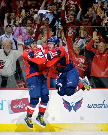 Alex Ovechkin, Sergei Fedorov. Washington Capitals left wing Alex Ovechkin, right, from Russia jumps into the arms of fellow countrymen Sergei Fedorov (91) after scoring his third goal of the game against the Pittsburgh Penguins during the third period of Game 2 of an NHL hockey second-round playoff series, in Washington. The Capitals won 4-3 and lead the best-of-seven games series 2-0