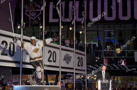 Former Los Angeles Kings left wing Luc Robitaille speaks after a statue of his likeness was unveiled in front of the Staples Center, prior to an NHL hockey game against the Pittsburgh Penguins in Los Angeles. Robitaille is currently the president of business operations for the Kings