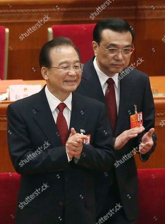 Li Kiqiang, Wen Jiabao. China's newly appointed Premier Li Kiqiang, right, and former Chinese Premier Wen Jiabao applaud at the closing session of the National People's Congress at the Great Hall of the People in Beijing China, . China's new leader Xi Jinping pledged a cleaner, more efficient government Sunday as the country's ceremonial legislature wrapped up a pivotal session that installed the latest generation of communist leaders in a once-a-decade transfer of power