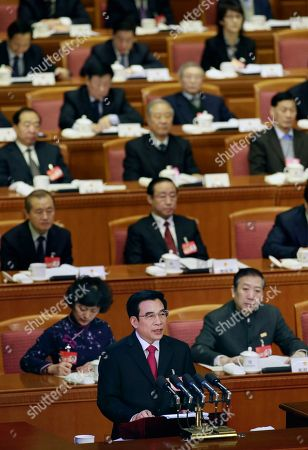 Beijing Mayor Wang Anshun reads a work report during an opening session of the 14th Beijing Municipality People's Congress in Beijing, . The people's congresses, are legislatures that meet once a year in full session to enact laws and approve government spending plans. The sessions are largely a formality, as the decisions have already been made by the Communist Party