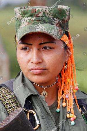 A female guerrilla of the Revolutionary Armed Forces of Colombia (FARC) manages a roadblock in San Isidro in southern Colombia, . Journalist Romeo Langlois, who was taken by rebels on April 28 when they attacked troops he was accompanying on a cocaine-lab eradication mission, is expected to be handed over by the rebels to a delegation that includes another French journalist in San Isidro