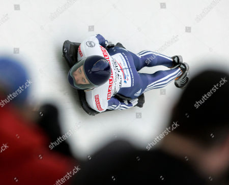 Stock Photo of Great Britain's Donna Creighton takes her third run during the women's Skeleton World Championships in Lake Placid, N.Y