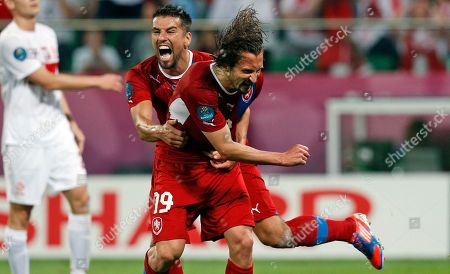 Czech Republic's Milan Baros celebrates teammate Petr Jiracek, right, scoring the opening goal during the Euro 2012 soccer championship Group A match between Czech Republic and Poland in Wroclaw, Poland