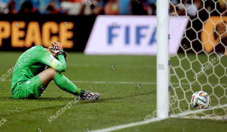 Netherlands' goalkeeper Jasper Cillessen reacts after being scored on by Argentina's Maxi Rodriguez during a penalty shootout after extra time during the World Cup semifinal soccer match between the Netherlands and Argentina at the Itaquerao Stadium in Sao Paulo Brazil, . Argentina defeated the Netherlands 4-2 in a penalty shootout after a 0-0 tie to advance to the finals