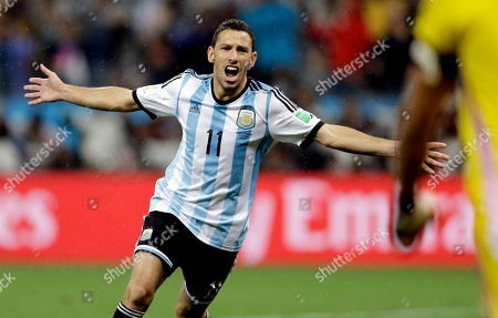 Argentina's Maxi Rodriguez celebrates after scoring the winning goal during a penalty shootout after extra time during the World Cup semifinal soccer match between the Netherlands and Argentina at the Itaquerao Stadium in Sao Paulo Brazil, . Argentina defeated the Netherlands 4-2 in a penalty shootout after a 0-0 tie to advance to the finals