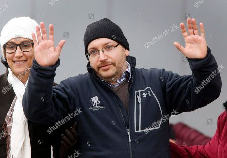 U.S. journalist Jason Rezaian gestures next to his wife Yeganeh Salehi as he poses for media people in front of Landstuhl Regional Medical Center in Landstuhl, Germany, . Rezaian was released from an Iranian prison last Saturday