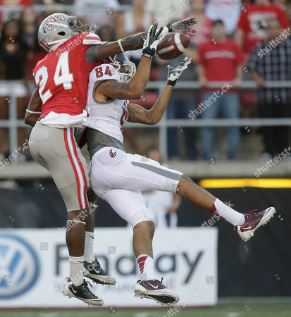 Washington State wide receiver Gabe Marks (84) catches a pass against UNLV defensive back Fred Wilson (24) during the first quarter of an NCAA college football game, in Las Vegas