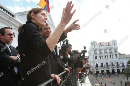 Stock Image of Ecuador's President Rafael Correa, third from left, talks with Christine Assange, the mother of WikiLeaks founder Julian Assange on the balcony of the presidential palace in Quito, Ecuador, . Christine Assange is in Ecuador to meet with officials about her son's political asylum request. Ecuadorean officials have said they will not announce a decision until after the London Olympic Games end in mid-August. The 40-year-old Australian has been holed up inside the Ecuadorian Embassy in London since applying for political asylum on June 19