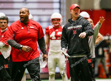 Greg Austin, Scott Frost. Nebraska head coach Scott Frost, right, and offensive line coach Greg Austin, left, shout instructions during spring training in Lincoln, Neb. Unlike the trend in the sport of less contact in practices instead of more, coach Frost wants Huskers' practices to be physical to toughen up his team