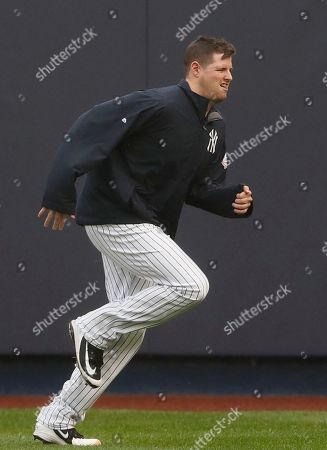 New York Yankees starting pitcher Jordan Montgomery warms up on the field beore the Yankees home opener baseball game in New York