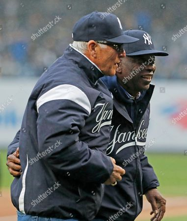 Stock Photo of Bucky Dent, Mickey Rivers. Former New York Yankees' Bucky Dent, left, and Mickey Rivers walk off the field after throwing out the ceremonial first pitches in the Yankees home opener baseball game at Yankee Stadium in New York
