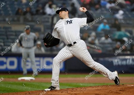 New York Yankees starting pitcher Jordan Montgomery winds up in a baseball game against the Tampa Bay Rays at Yankee Stadium in New York