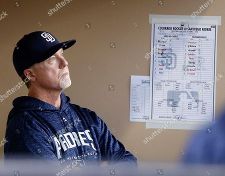 San Diego Padres bench coach Mark McGwire looks out from the dugout before a baseball game against the Colorado Rockies in San Diego