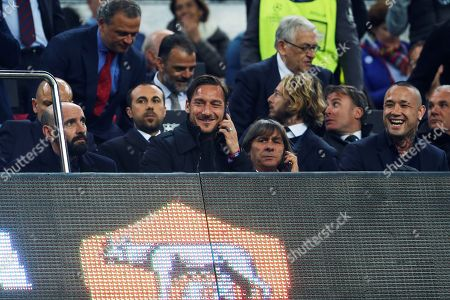 (L-R first row) AS Roma's sports director Spanish Ramon Rodriguez 'Monchi', AS Roma former player Francesco Totti and AS Roma midfielder Radja Nainggolan during the UEFA Champions League quarter final first leg match between FC Barcelona and AS Roma at Camp Nou stadium, in Barcelona, Catalonia, Spain, 04 April 2018.