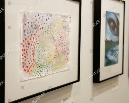 This Nov. 27, 2017 photo shows artwork made by detainees of the Guantanamo Bay Detention Camp, at an exhibit at at the John Jay College of Criminal Justice in New York, including a piece, far left, by Ammar Al Baluchi, a nephew of alleged 9/11 mastermind Khalid Sheikh Mohammed. Al Baluchi, accused of helping to plan the Sept. 11 attacks, wants to be able to distribute art he makes in his cell at the detention center. His attorneys sent a motion to a military commission, saying the Department of Defense has violated his rights by making it more difficult for him to draw and paint and by blocking him from giving his artwork to his attorneys