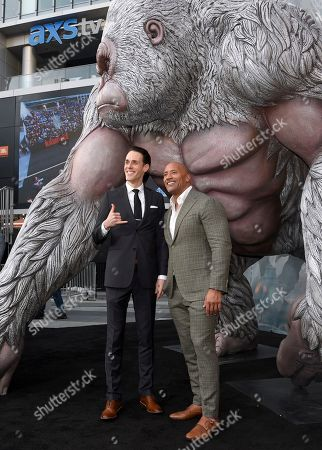 """Jason Liles, Dwayne Johnson. Jason Liles, left, and Dwayne Johnson arrive at the world premiere of """"Rampage"""" at the Microsoft Theater, in Los Angeles"""
