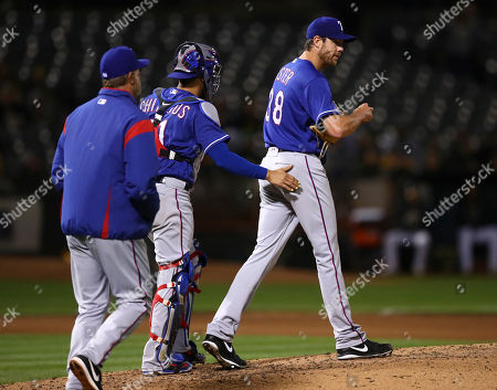 Doug Fister, Robinson Chirinos, Doug Brocail. Texas Rangers pitcher Doug Fister, right, walks back to the mound as pitching coach Doug Brocail, left, and catcher Robinson Chirinos approach in the fourth inning of a baseball game against the Oakland Athletics, in Oakland, Calif