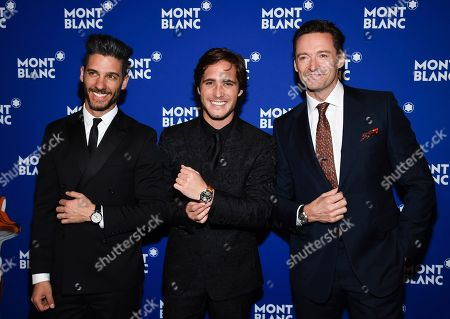 Stock Photo of Erick Elias, Diego Boneta, Hugh Jackman. Actors Erick Elias, left, Diego Boneta and Hugh Jackman attend Montblanc's celebration of the 75th anniversary of Le Petit Prince at One World Observatory, in New York