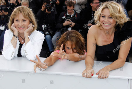 Stock Picture of Alexandra Rapaport, Susse Wold, Sisse Graum Jorgensen. From left, actresses Susse Wold, Alexandra Rapaport and producer Sisse Graum Jorgensen pose during a photo call for The Hunt at the 65th international film festival, in Cannes, southern France