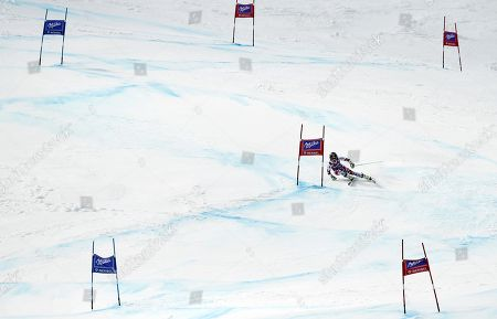 Anna Fenninger, of Austria, speeds down the course on her way to win an alpine ski, women's World Cup giant slalom, at the World Cup finals in Meribel, France