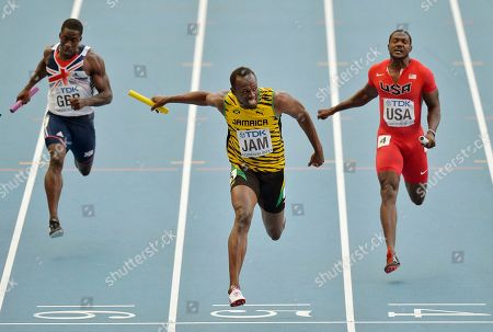 Stock Picture of Jamaica's Usain Bolt, center, crosses the finish line to win ahead of United States' Justin Gatlin, right, and Britain's Dwayne Chambers in the men's 4x100-meter relay final at the World Athletics Championships in the Luzhniki stadium in Moscow, Russia