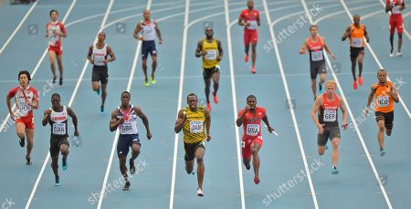 Jamaica's Usain Bolt, center, United States' Justin Gatlin, third from right, and Britain's Dwayne Chambers, third from left, compete in the men's 4x100-meter relay final at the World Athletics Championships in the Luzhniki stadium in Moscow, Russia
