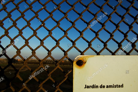 """Stock Picture of An old plate hangs on the U.S.-Mexico border fence which reads in Spanish """"Friendship Garden"""" in Tijuana, Mexico, . The U.S. Border Patrol will close the park on a bluff overlooking the Pacific Ocean to make way for a triple fence, people who were informed by the agency said Wednesday. Friendship Park, in the U.S. which was dedicated in 1971 by then-First Lady Patricia Nixon, draws big crowds on both sides of the border, especially on summer weekends"""