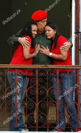 Hugo Chavez, Maria Gabriela Chavez, Rosa Virginia Chavez. Venezuela's President Hugo Chavez kisses his daughter Maria Gabriela, right, and embraces daughter Rosa Virginia after greeting supporters at a balcony of Miraflores presidential palace in Caracas, Venezuela, . Chavez returned to Venezuela from Cuba on Monday morning, stepping off a plane hours before dawn and saying he is feeling better as he recovers from surgery that removed a cancerous tumor