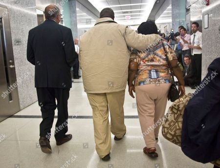 David McCallum, center, walks with his mother Ernestine McCallum and lawyer Oscar Michelen, left, to a news conference after his exoneration, in New York. McCallum and Willie Stuckey, who died in prison, were 16 years old when they were convicted of murder. A judge exonerated both men for wrongful conviction