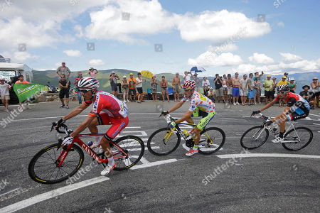 Stage winner Poland's Rafal Majka, center, Spain's Joaquim Rodriguez, left, and Luxembourg's Frank Schleck, right, climb towards Saint-Lary during the seventeenth stage of the Tour de France cycling race over 124.5 kilometers (77.4 miles) with start in Saint-Gaudens and finish in Saint-Lary, France
