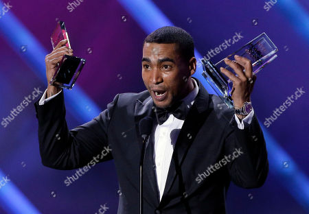 Puerto Rico reggaeton star Don Omar receives his tenth award at the Latin Billboard Awards in Coral Gables, Fla. Authorities said in a statement that 36-year-old William Omar Landron Rivera was detained early, at a house in the northern coastal Puerto Rican town of Vega Alta. Authorities said he is suspected of threatening his 26-year-old partner