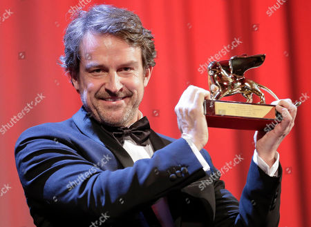 Director Lorenzo Vigas receives the Golden Lion for best film for 'Desde Alla' (From afar) during the awards ceremony of the 72nd edition of the Venice Film Festival in Venice, Italy