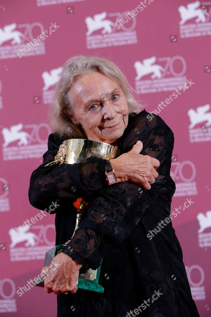 Actress Elena Cotta holds her Volpi Cup for Best Actress for her role in the film Via Castellana Bandiera, during the awards photo call at the 70th edition of the Venice Film Festival in Venice, Italy