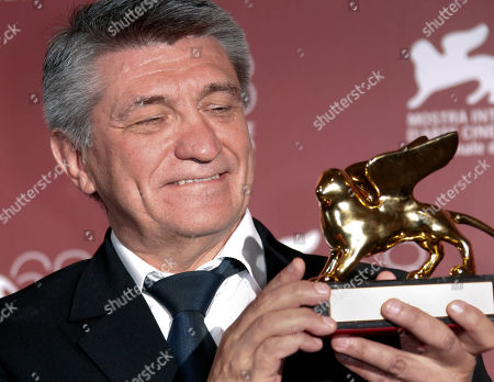 Stock Picture of Director Aleksandr Sokurov holds the Golden Lion for best film for Faust, during the winners' photo call of the 68th edition of the Venice Film Festival in Venice, Italy