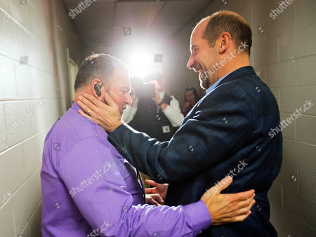 John Smoltz, Jim Lovell. Former Atlanta Braves pitcher John Smoltz, right, embraces Braves assistant athletic trainer Jim Lovell as he leaves a press conference after his election to baseball's Hall of Fame, in Atlanta