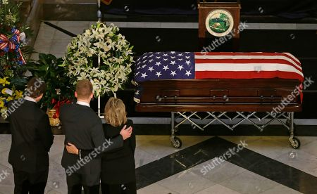 Family members stand at the casket containing the remains of former Indiana Congressman Andrew Jacobs Jr. before visitation and funeral service at the Statehouse, in Indianapolis. Jacobs died Saturday, Dec. 28, 2013, at age 81