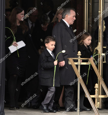 Former Chicago Mayor Richard M. Daley, holding the hands of his grandchildren, follows the casket of his wife, Maggie Daley, out of the Chicago Cultural Center, in Chicago on the way to her funeral Mass. Mrs, Daley died Thursday, Nov. 24. She was 68