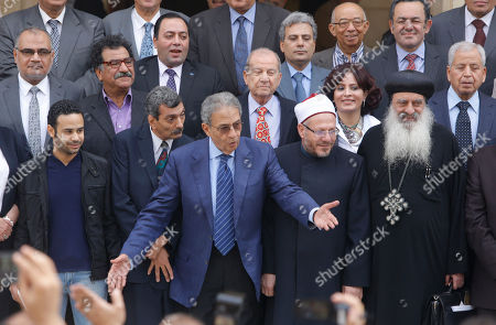 Amr Moussa, center, the chairman of Egypt's 50-member panel tasked with amending Egypt's Islamist-drafted constitution, arranges the members for a group picture after finishing the final draft of a series of constitutional amendments at the Shoura Council in Cairo, Egypt, . Adoption of the new charter will be a giant step in the implementation of the roadmap announced by the nation's military chief when he toppled Morsi in a July 3 coup. The next steps will be parliamentary and presidential elections in the spring and summer of 2014