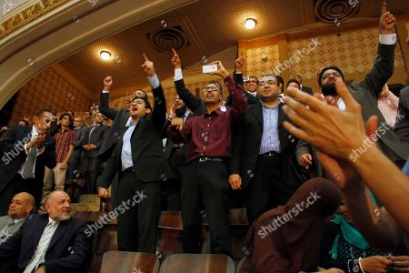 Mohammed Morsi, Wael Ghonim. Egyptian activist and former Google executive Wael Ghonim, fourth from right, reacts along with other guests as Egypt's newly inaugurated President Mohammed Morsi appears at Cairo University in Cairo, Egypt, . Morsi was sworn in Saturday as Egypt's first freely elected president and the Arab world's first Islamist head of state