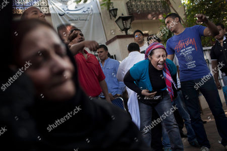 Egyptian supporters of former presidential candidate Ahmed Shafiq react after hearing the final results of the elections in Cairo, Egypt, . Mohammed Morsi was declared Egypt's first Islamist president on Sunday after the freest elections in the country's history, narrowly defeating Hosni Mubarak's last Prime Minister Ahmed Shafiq in a race that raised political tensions in Egypt to a fever pitch