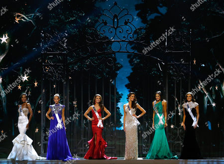Tiana Griggs, Alyson Guidry, Nia Sanchez, Brittany Oldehoff, Audra Mari, Carlyn Bradarich. Miss Georgia USA Tiana Griggs, from left, Miss Louisiana USA Brittany Alyson Guidry, Miss Nevada USA Nia Sanchez, Miss Florida USA Brittany Oldehoff, Miss North Dakota USA Audra Mari and Miss Iowa USA Carlyn Bradarich, stand during the Miss USA pageant in Baton Rouge, La., . Sanchez would go on to win the Miss USA title