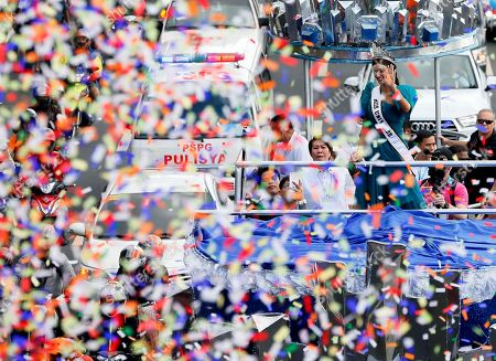 Confetti rain on newly crowned Miss Universe Pia Alonzo Wurtzbach during a victory parade in Manila, Philippines. Wurtzbach returned home to the Philippines for the first time since her crowning - and that awkward moment when host Steve Harvey mistakenly crowned Miss Colombia instead of her in Las Vegas on Dec. 20, 2015. Thousands of Filipinos lined the parade route to take a glimpse of the third Filipino to be crowned Miss Universe